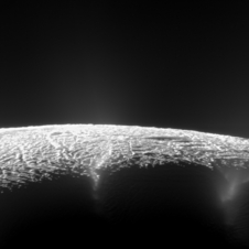 Cracks in the surface of Saturn's moon.  Water is erupting through the cracks into space from subterranean seas.